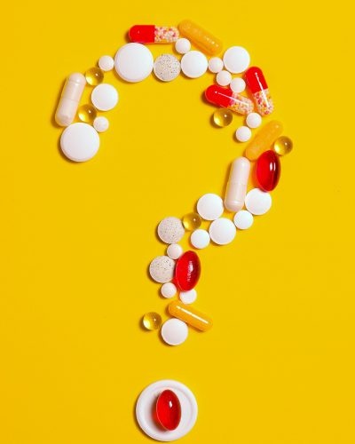 medication-pills-isolated-on-yellow-background-3683098